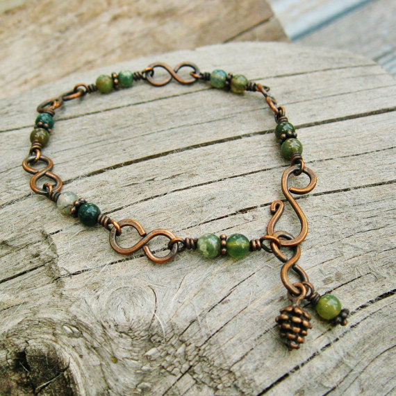 In the Forest -Fancy Jasper greens and antiqued copper wire wrapped bracelet with infinity links and a pinecone dangle by BearRunOriginals
